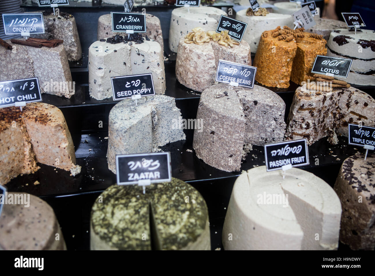 selectiono of various flavours of halva on tel aviv street market - Stock Image