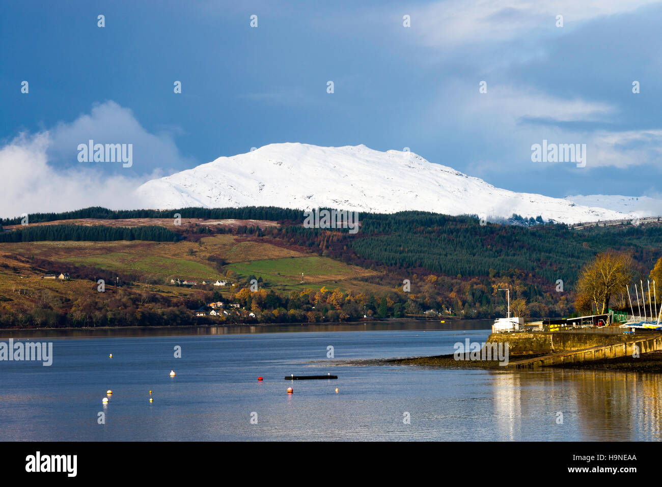 The View Over Gare Loch to a Snow Covered Creachan Mor Hill near Rhu in Scotland United Kingdom UK - Stock Image