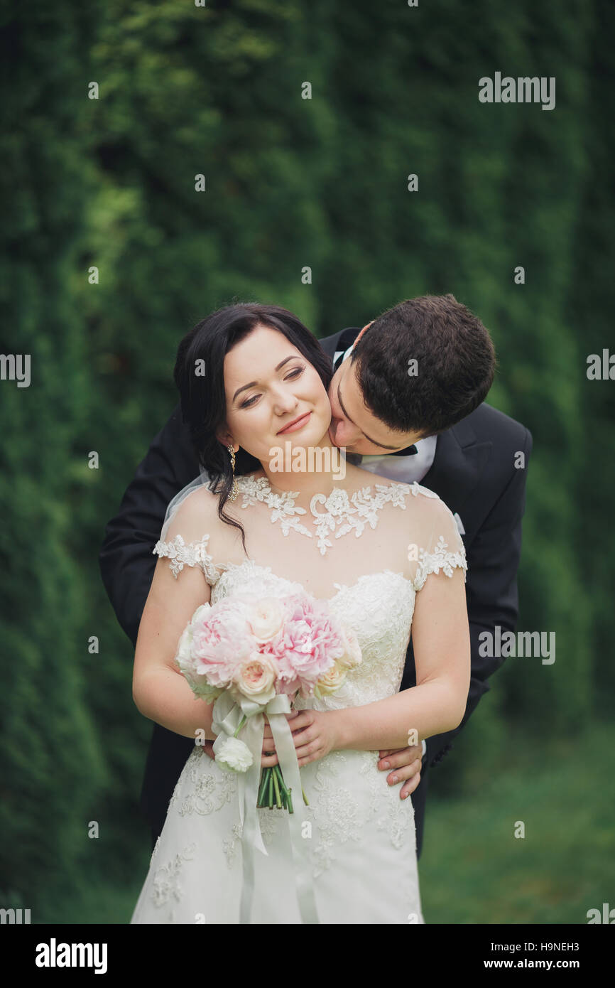 Beautiful Romantic Wedding Couple Of Newlyweds Hugging In Park On Stock Photo Alamy
