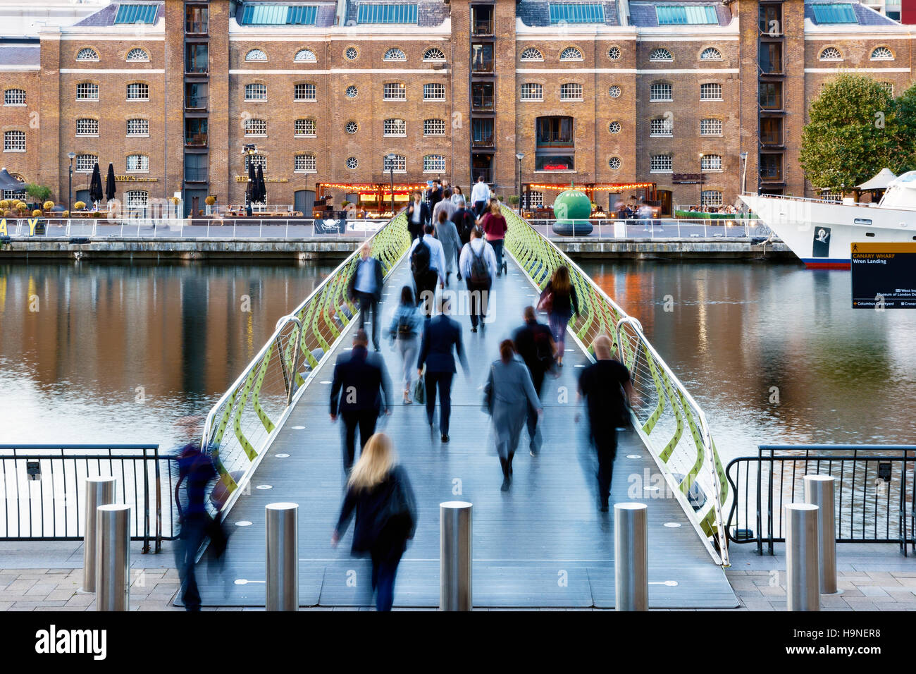 London, UK - September 21, 2016 - People crossing the North Dock Footbridge from Canary Wharf to West India Quay - Stock Image