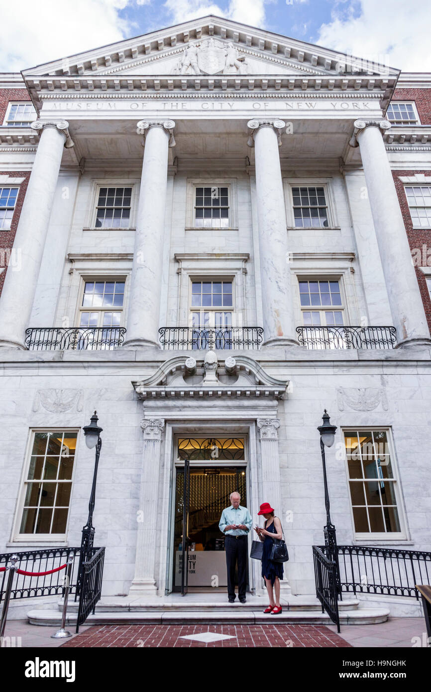 Manhattan New York City NYC NY East Harlem Museum of the City of New York history entrance man woman couple pediment - Stock Image