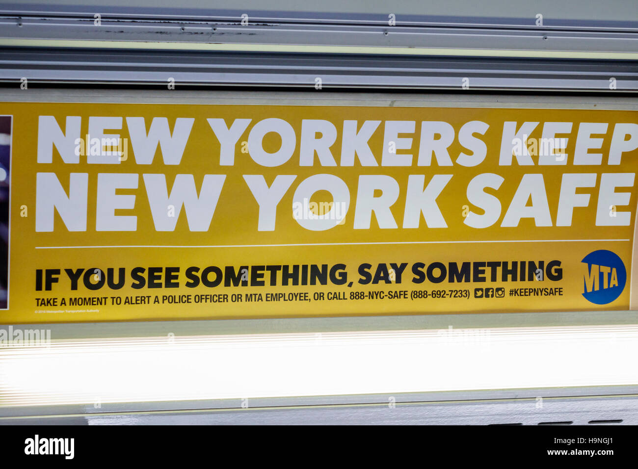 Manhattan New York City NYC NY sign bus billboard ad public safety reporting crime New Yorkers Keep New York Safe - Stock Image
