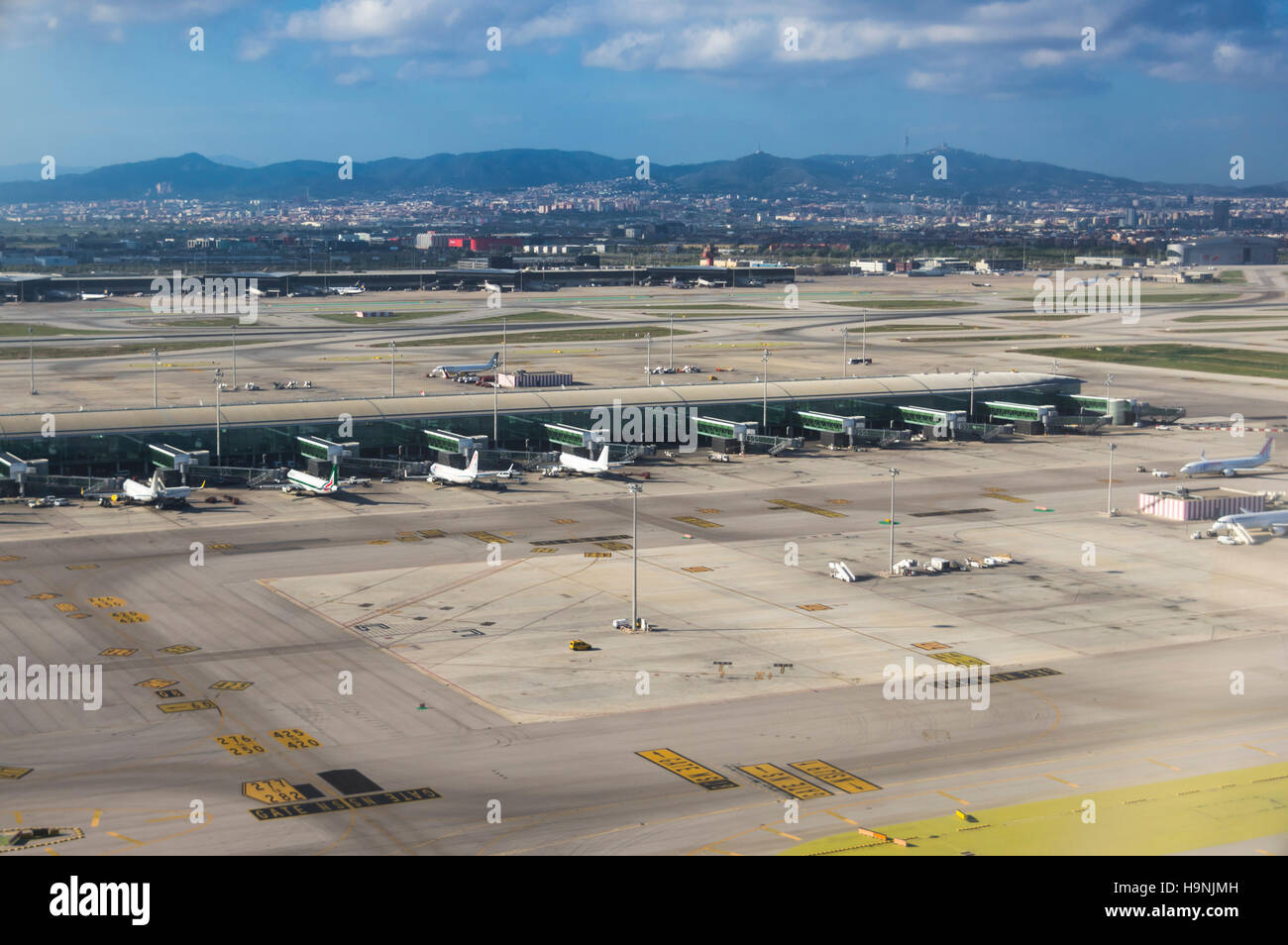 Aerial photography of Barcelona El Prat international airport with terminal T1 in the foreground. - Stock Image