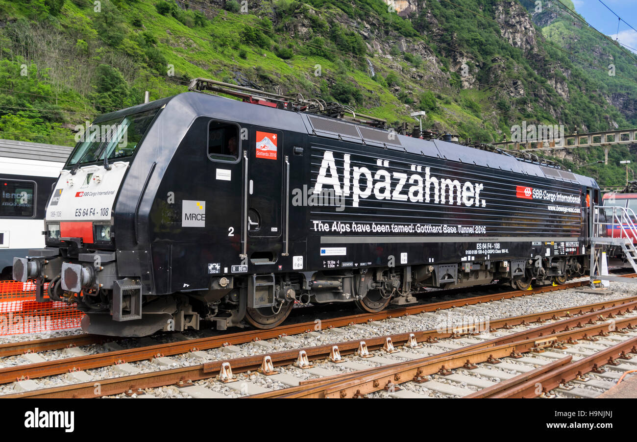 Siemens ES64F4 electric locomotive operated by SBB Cargo in special livery, celebrating the opening of Gotthard - Stock Image