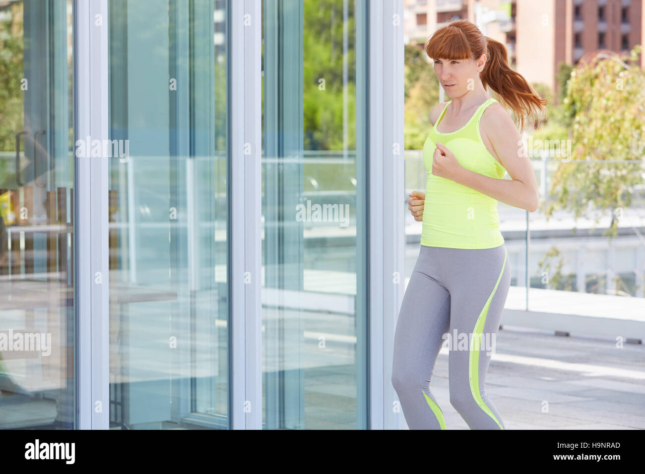 Woman running outdoor in the modern city - Stock Image