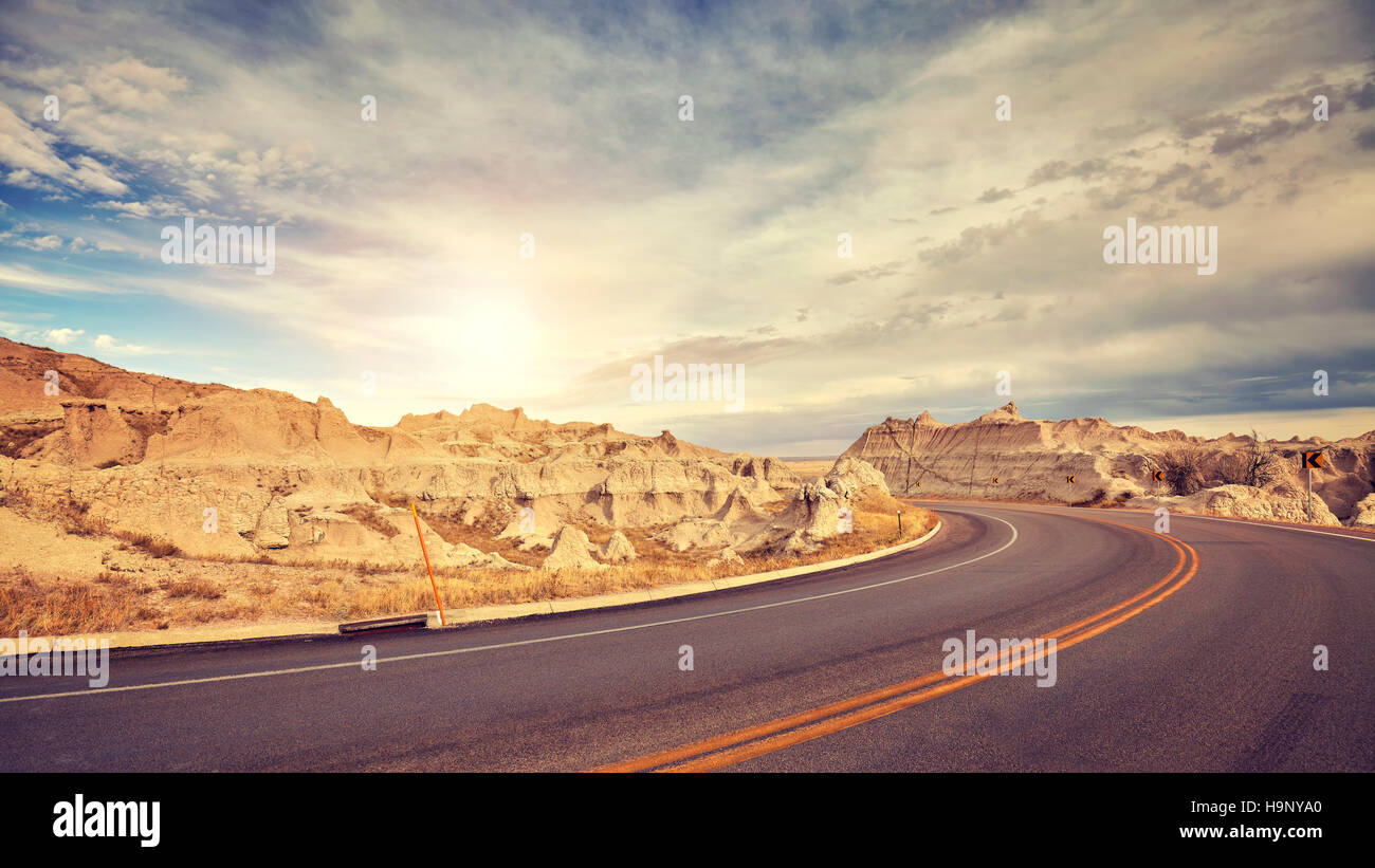 Vintage toned desert road just before sunset, travel concept, USA. - Stock Image