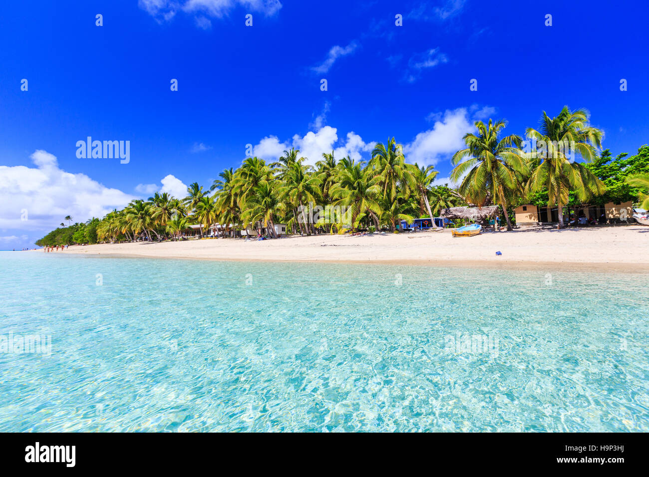 Beach on a tropical island with clear blue water. Dravuni Island, Fiji. - Stock Image