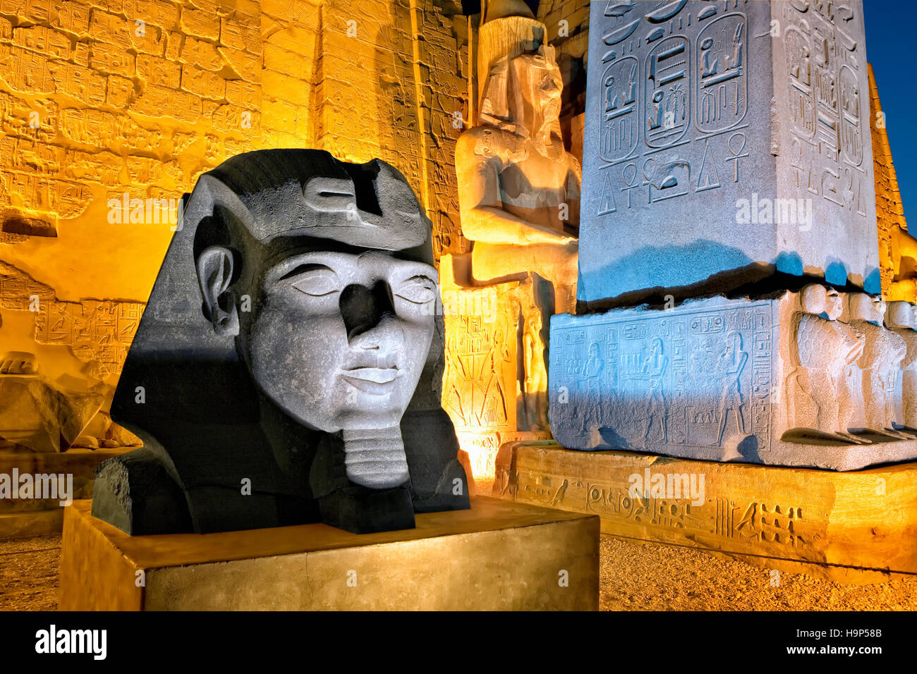 Statue of the pharaoh Ramses II in Luxor Temple, Egypt - Stock Image
