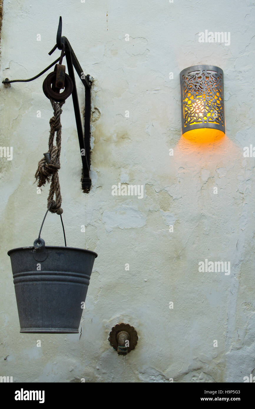 Old fountain with light of a lamp in town of Vejer, Cadiz. Spain - Stock Image