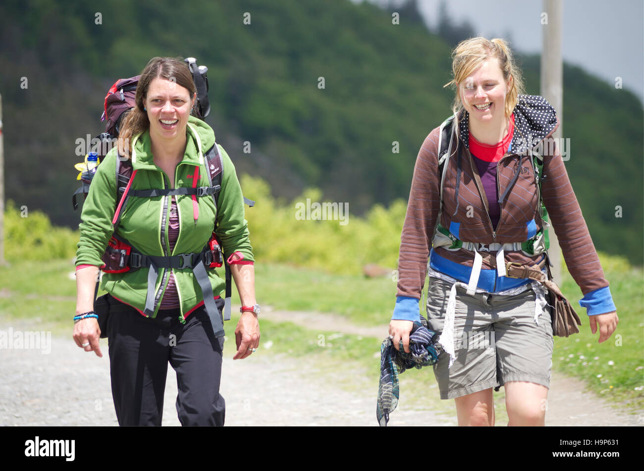 Female pilgrims on the first day of the route to Santiago de Compostela, Roncesvalles pass - Stock Image