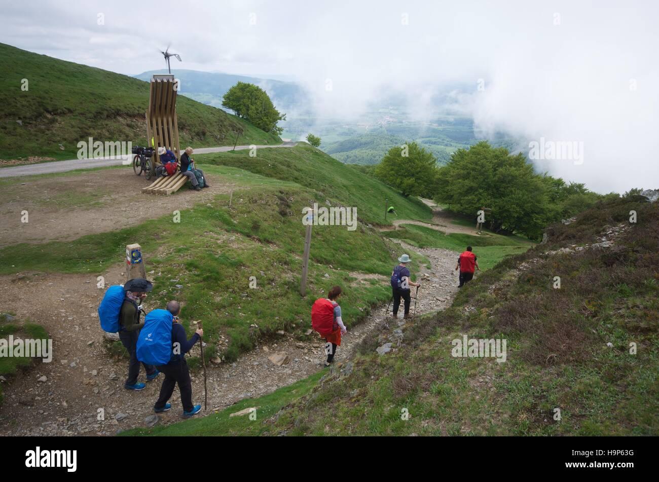 Pilgrims walking on the Ronvesvalles pass, Pilgrim road to Santiago de Compostela - Stock Image