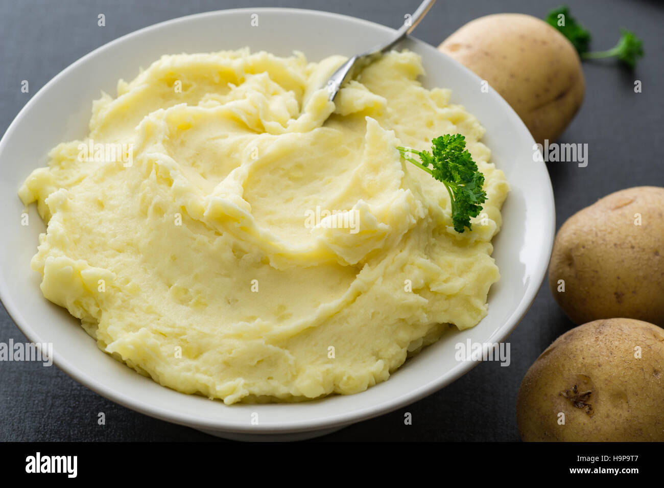 A bowl homemade mashed potato. Potatoes, double cream, butter and salt. - Stock Image