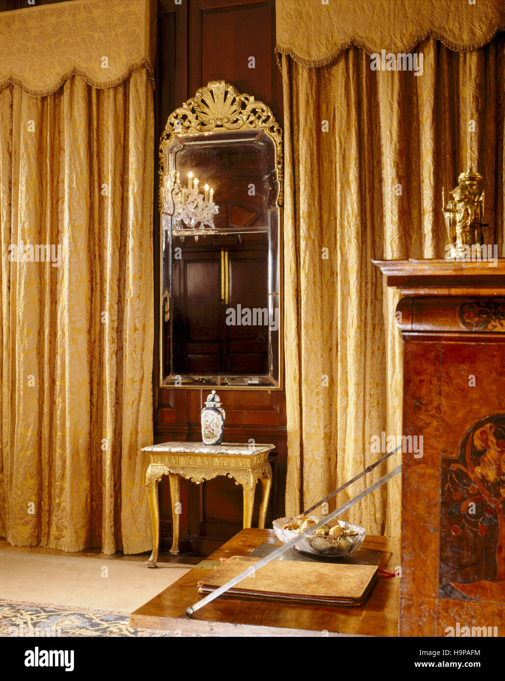 Partial room view of the Saloon at Antony House showing the Queen Anne pier-glass, made for the room with bevelled - Stock Image