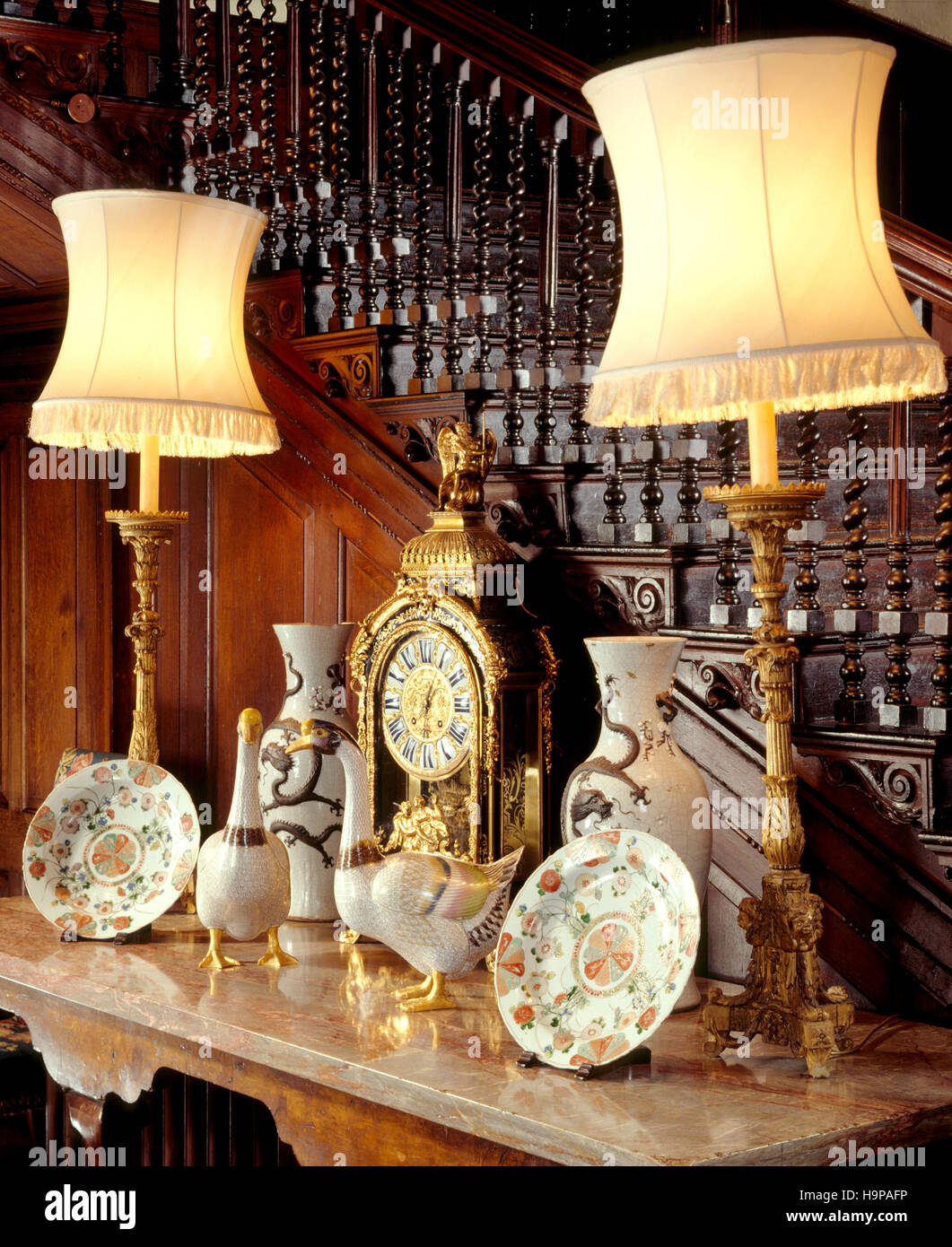 Partial view of the Inner Hall at Antony House showing the marble top table, ceramic geese, clock, table lamps, - Stock Image