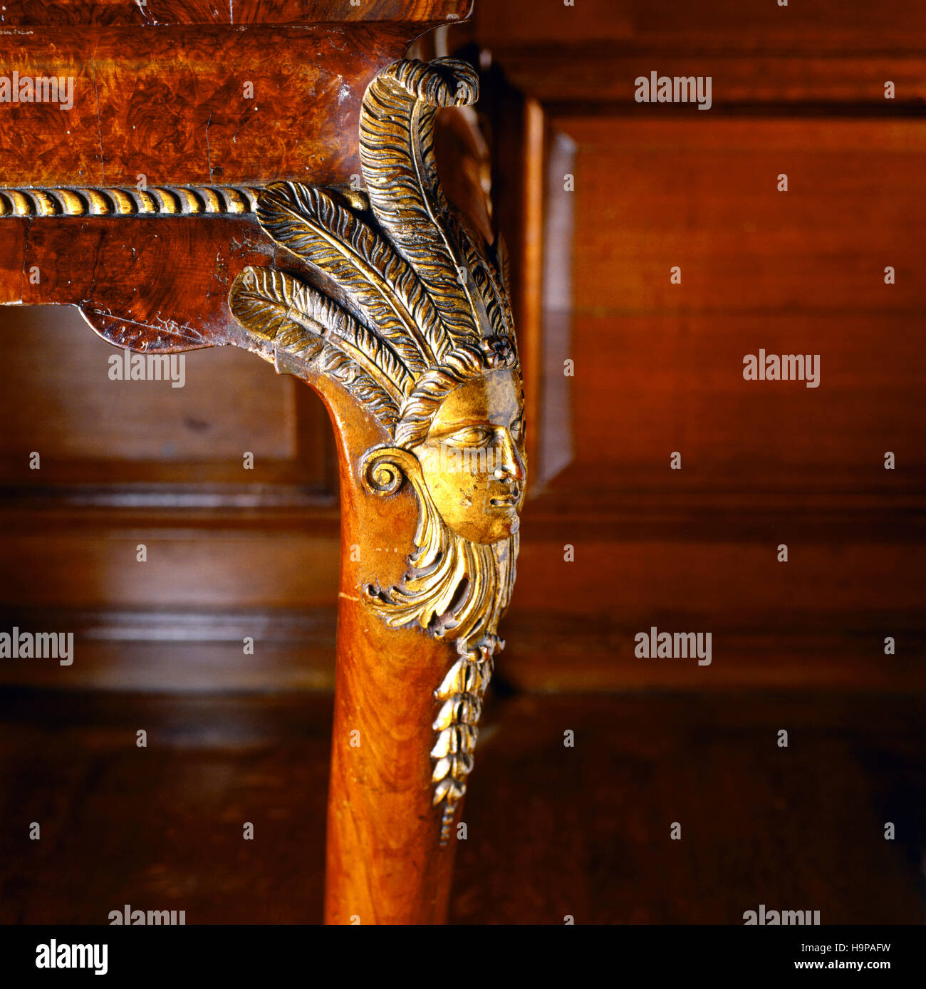 Detail of carved cabriole legs of C18th walnut tables in the Tapestry Room. Gilded carving at the knees of Mexican - Stock Image