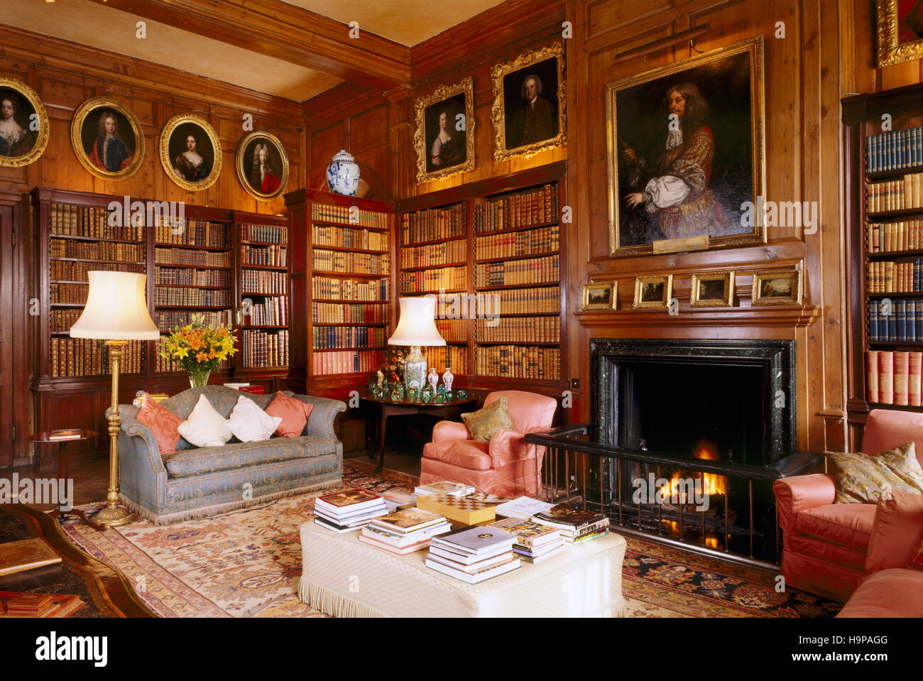 Room view of the Library in Antony House showing fireplace, bookcase, chairs and pine paneling. - Stock Image