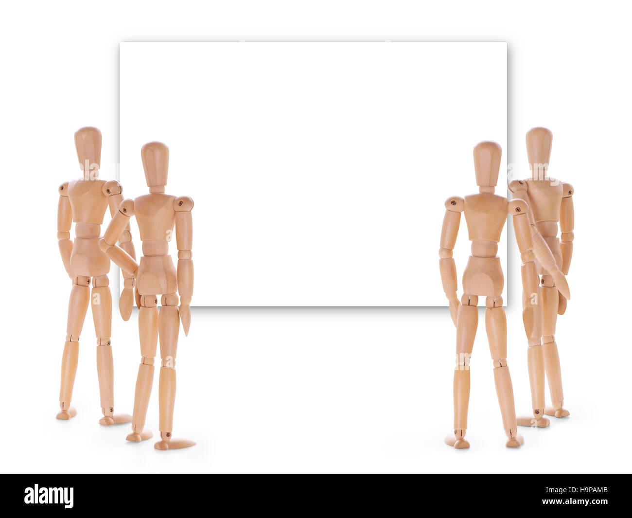 Group of wooden people looking at empty screen. Exposition, presentation, premiere, announcement and audience interest - Stock Image