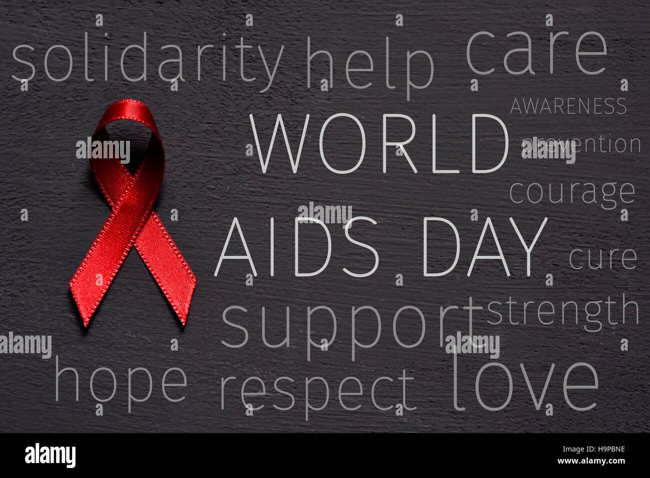 a red ribbon for the fight against AIDS, the text world aids day and some other words relative to it, like hope, - Stock Image