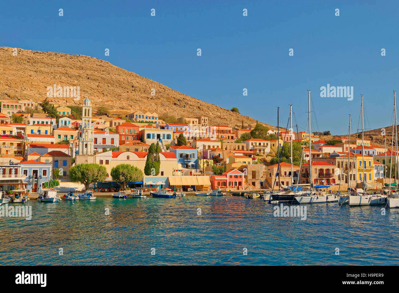Chalki town on the Greek island of Chalki situated off the north coast of Rhodes in the Dodecanese Island group, - Stock Image