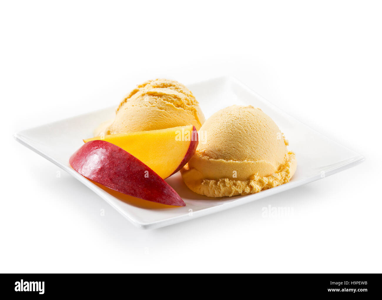 Fresh mango ice cream isolated on white Stock Photo