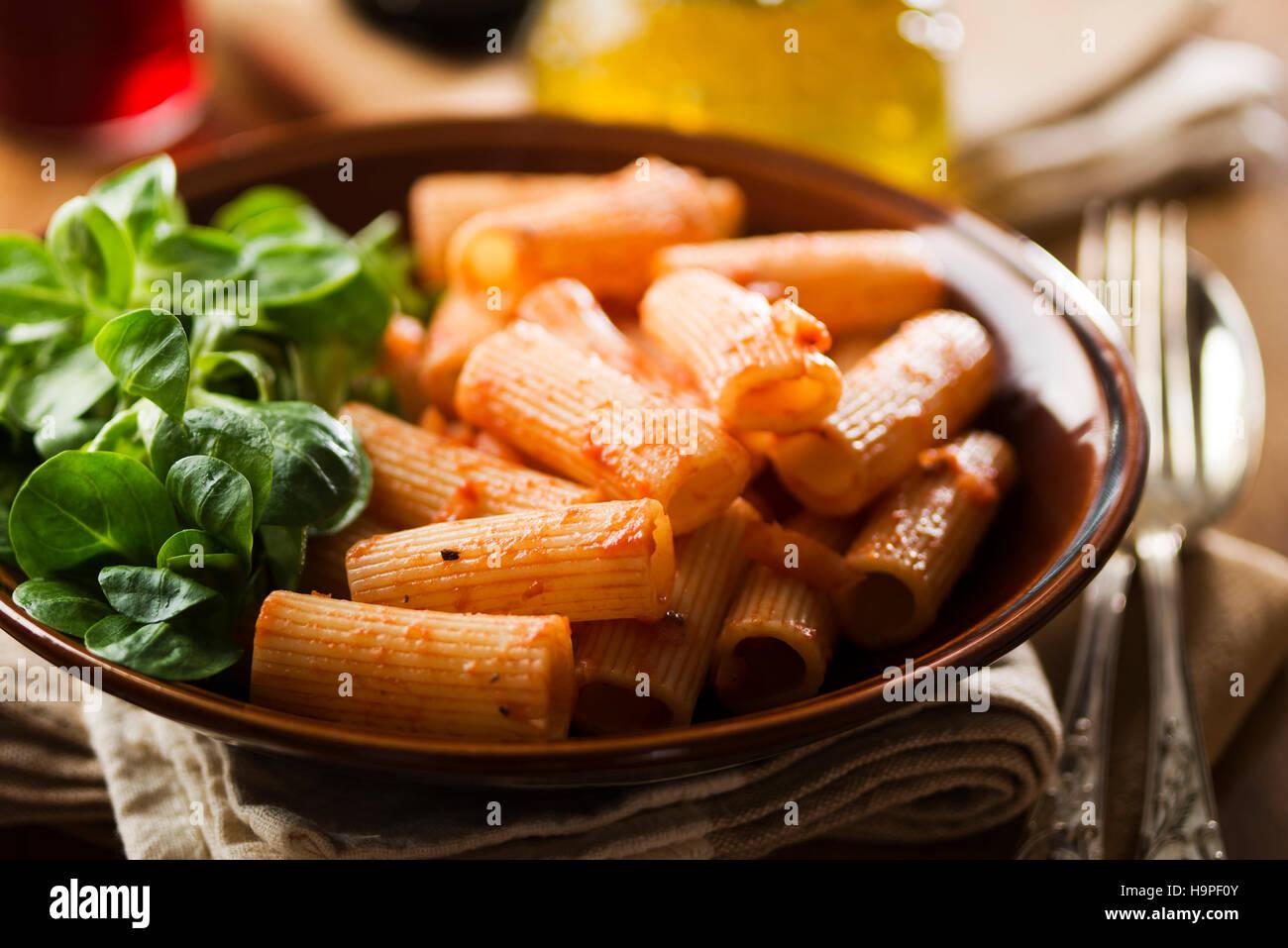 Macaroni pasta with tomato sauce close up - Stock Image