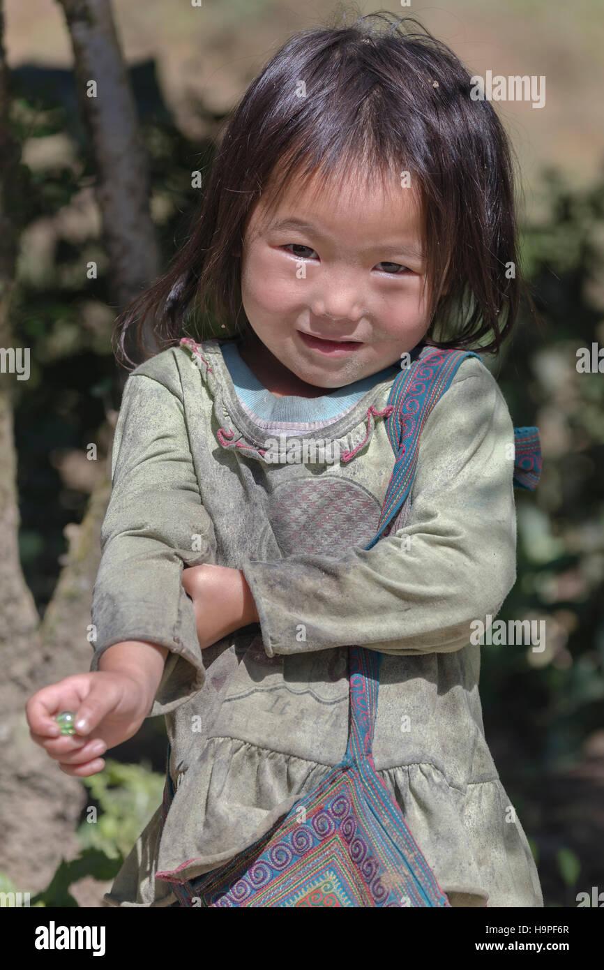 minority girl in the tribal village Lao Chai in Sapa, Vietnam, Asia - Stock Image