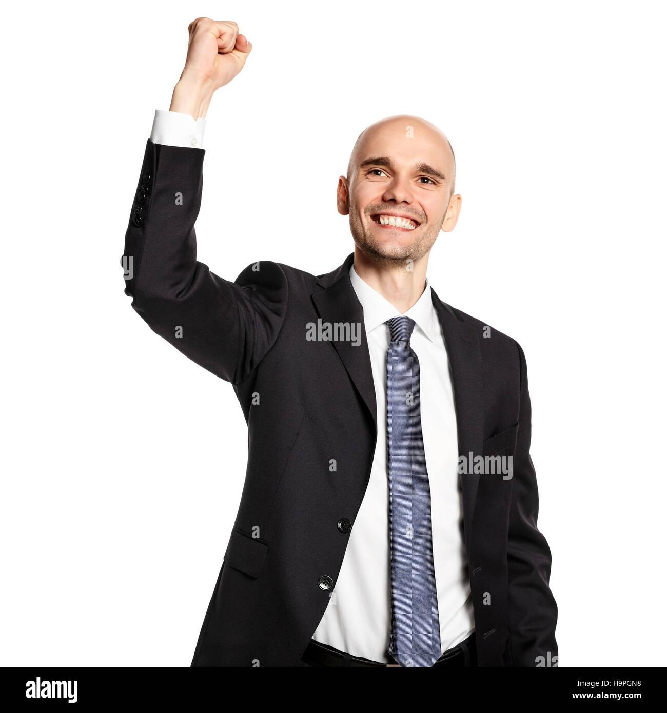 Studio shot of happy young businessman celebrating his success. - Stock Image
