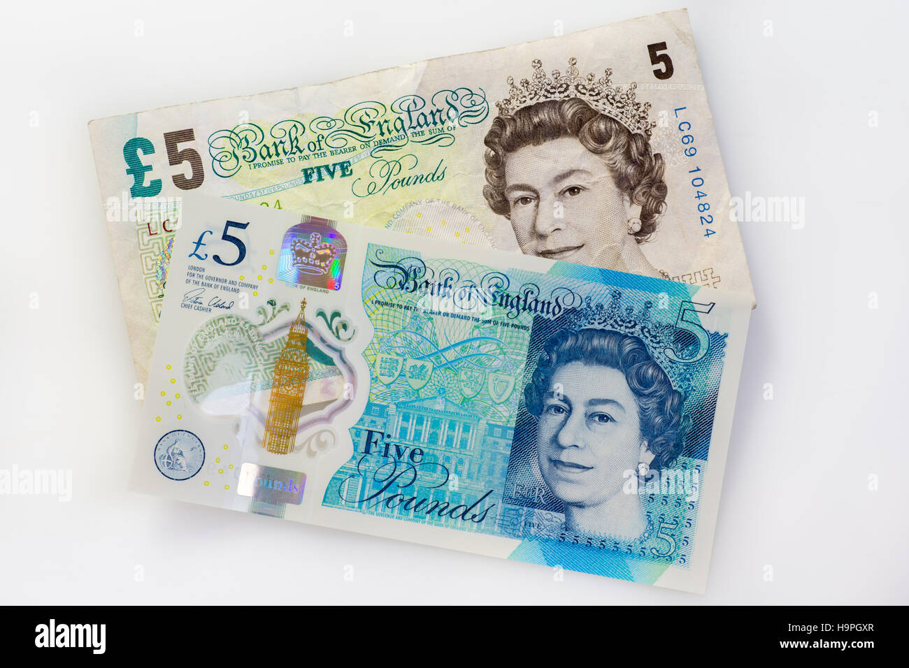 New 2016 British five pound note and old paper note together - Stock Image