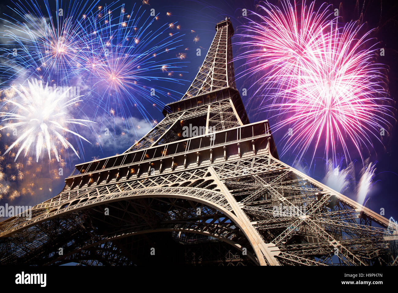 Eiffel tower with fireworks, celebration of the New Year in Paris, France - Stock Image