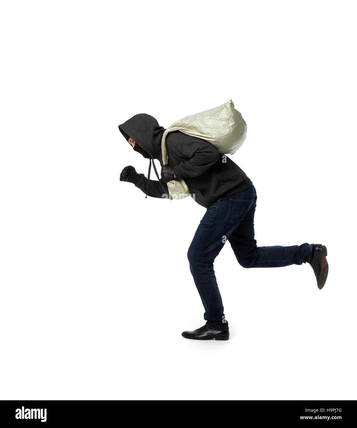 Thief escapes with full bag - Stock Image