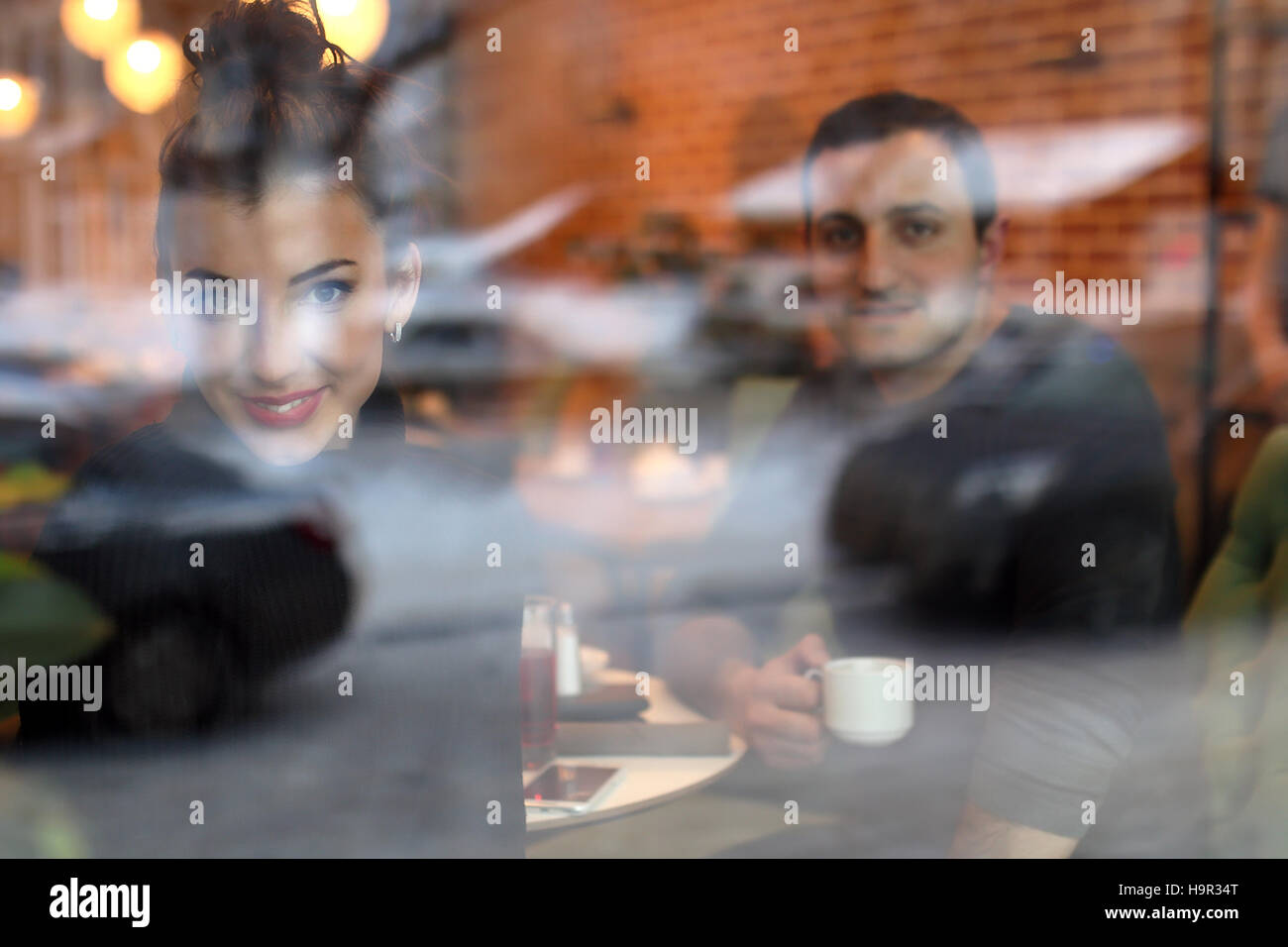 young couple meets in a cafe on a date - Stock Image