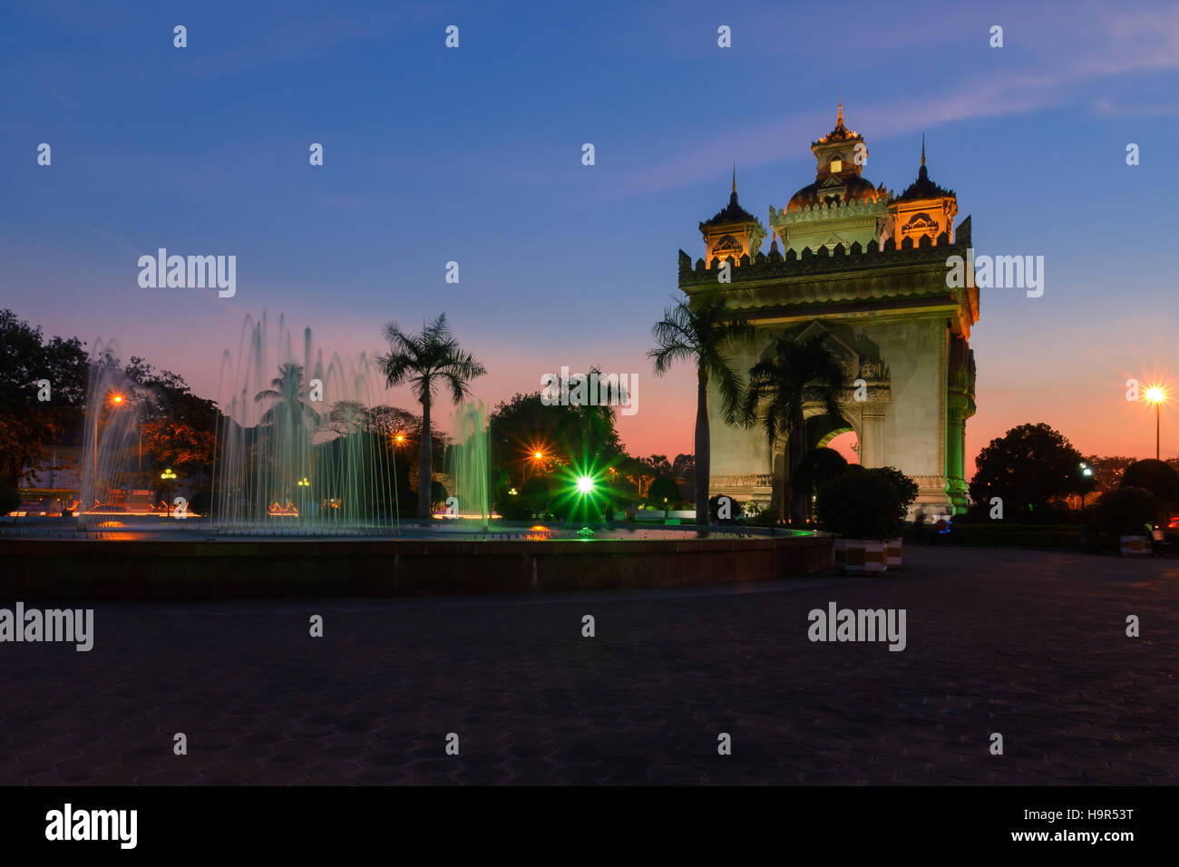 Patuxai arch landmark of Vientiane, Laos at twilight time. - Stock Image