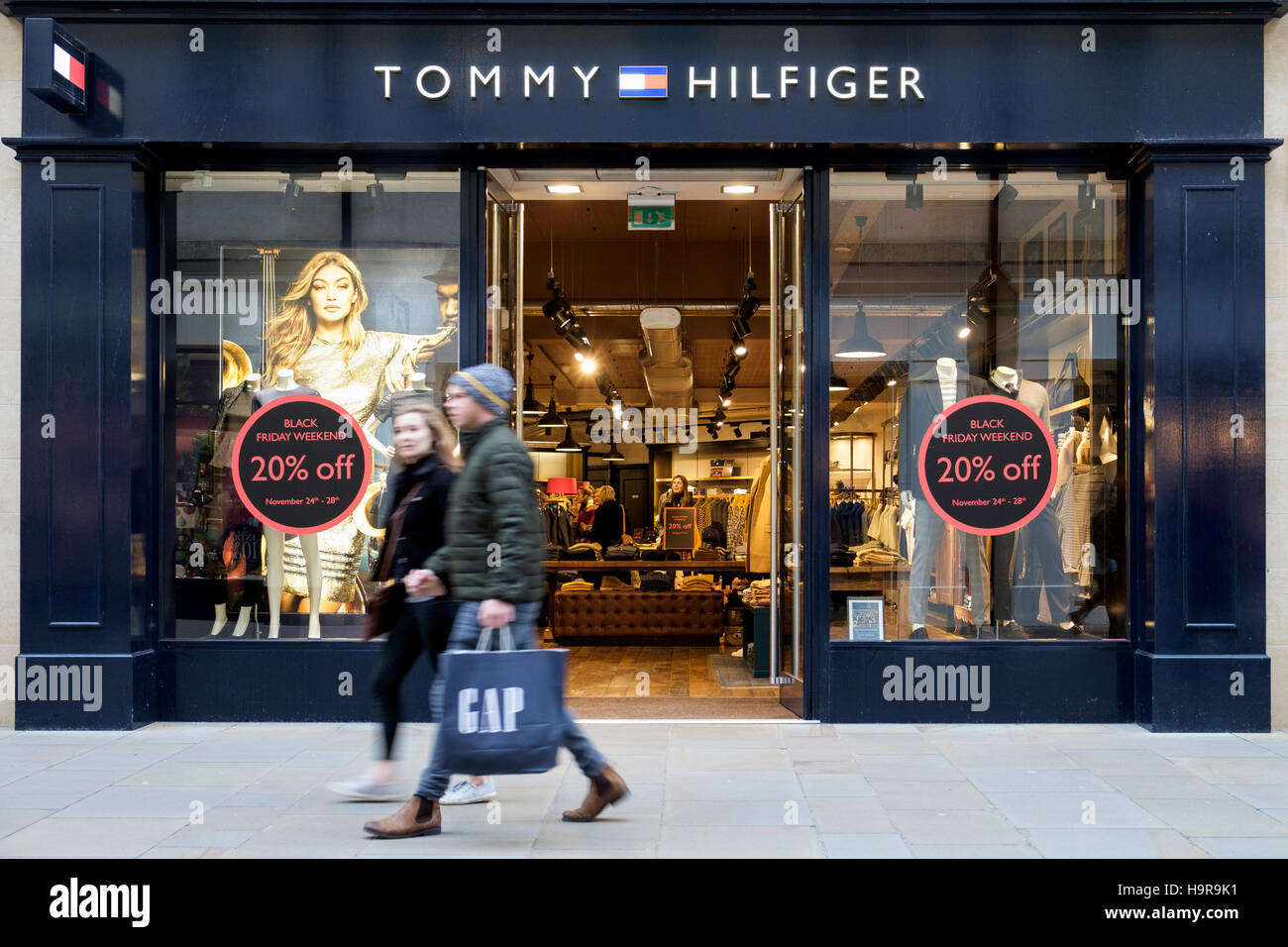 32b55d9b With Black Friday sales due to start on Friday, shoppers are pictured as  they walk past a Tommy Hilfiger store in the centre of Bath,UK.