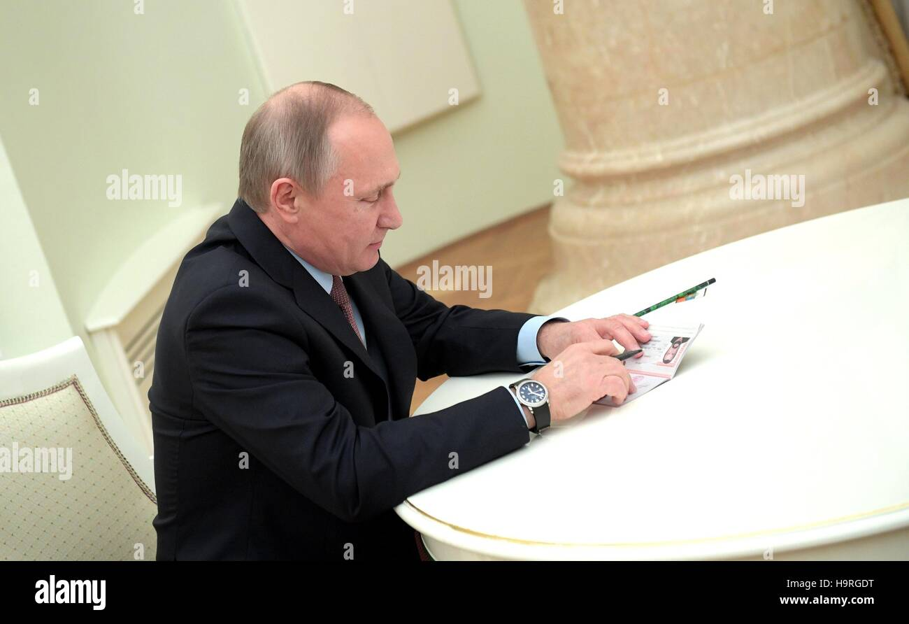 Russian President Vladimir Putin signs a Russian passport for American actor Steven Seagal granting him citizenship - Stock Image