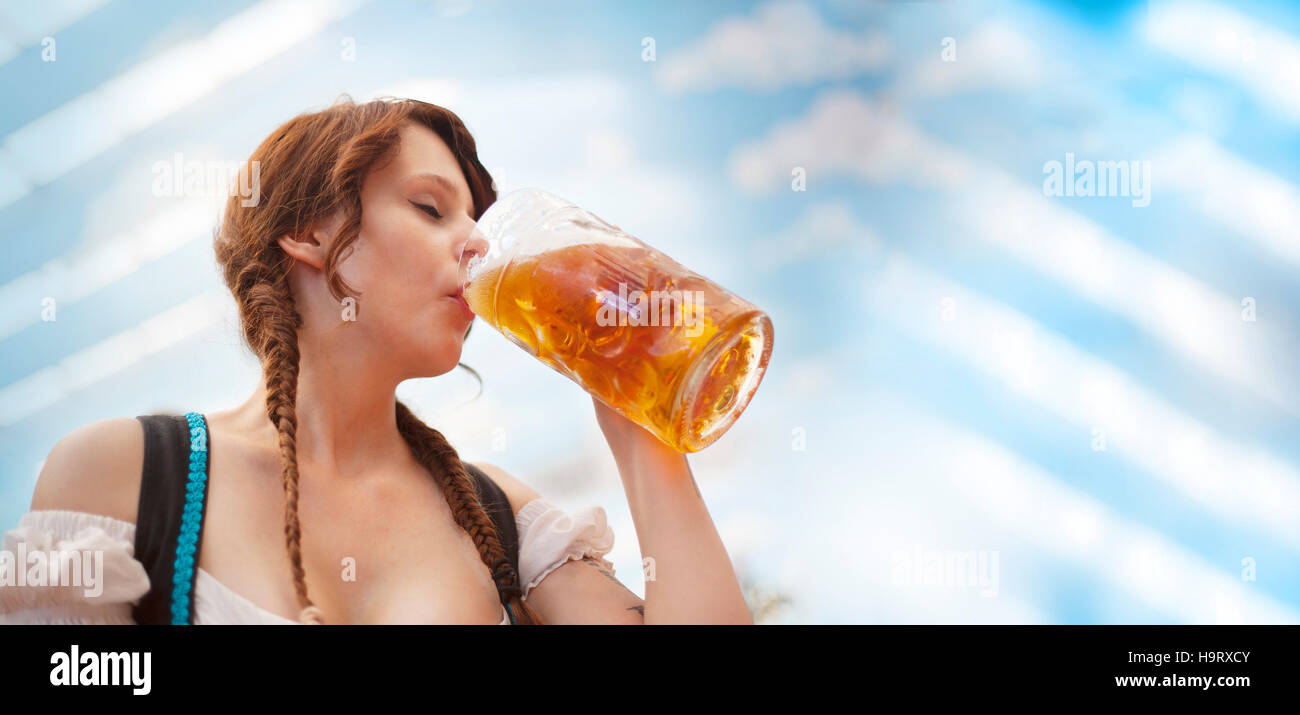 Oktoberfest Banner - German woman drinking beer - Stock Image