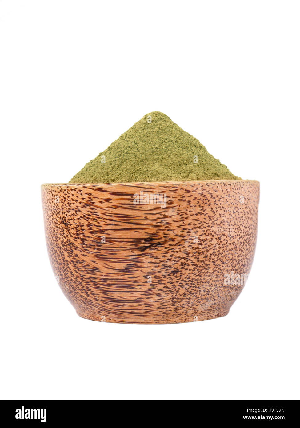 Henna lawsonia inermis powder in the coconut bowl isolated on white - Stock Image