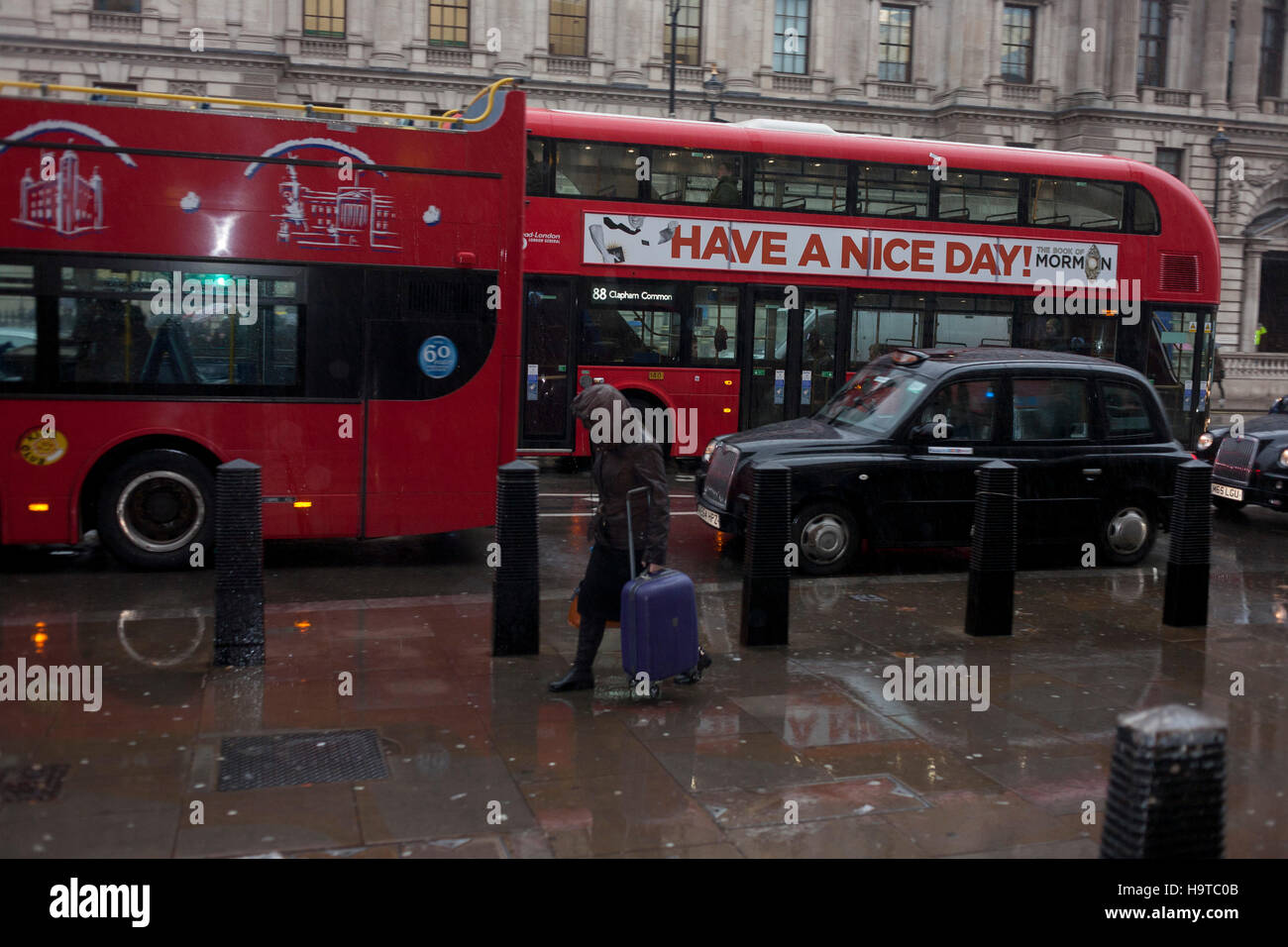 'Have a Nice Day' banner on a central London bus during a morning shower in Whitehall, central London. - Stock Image