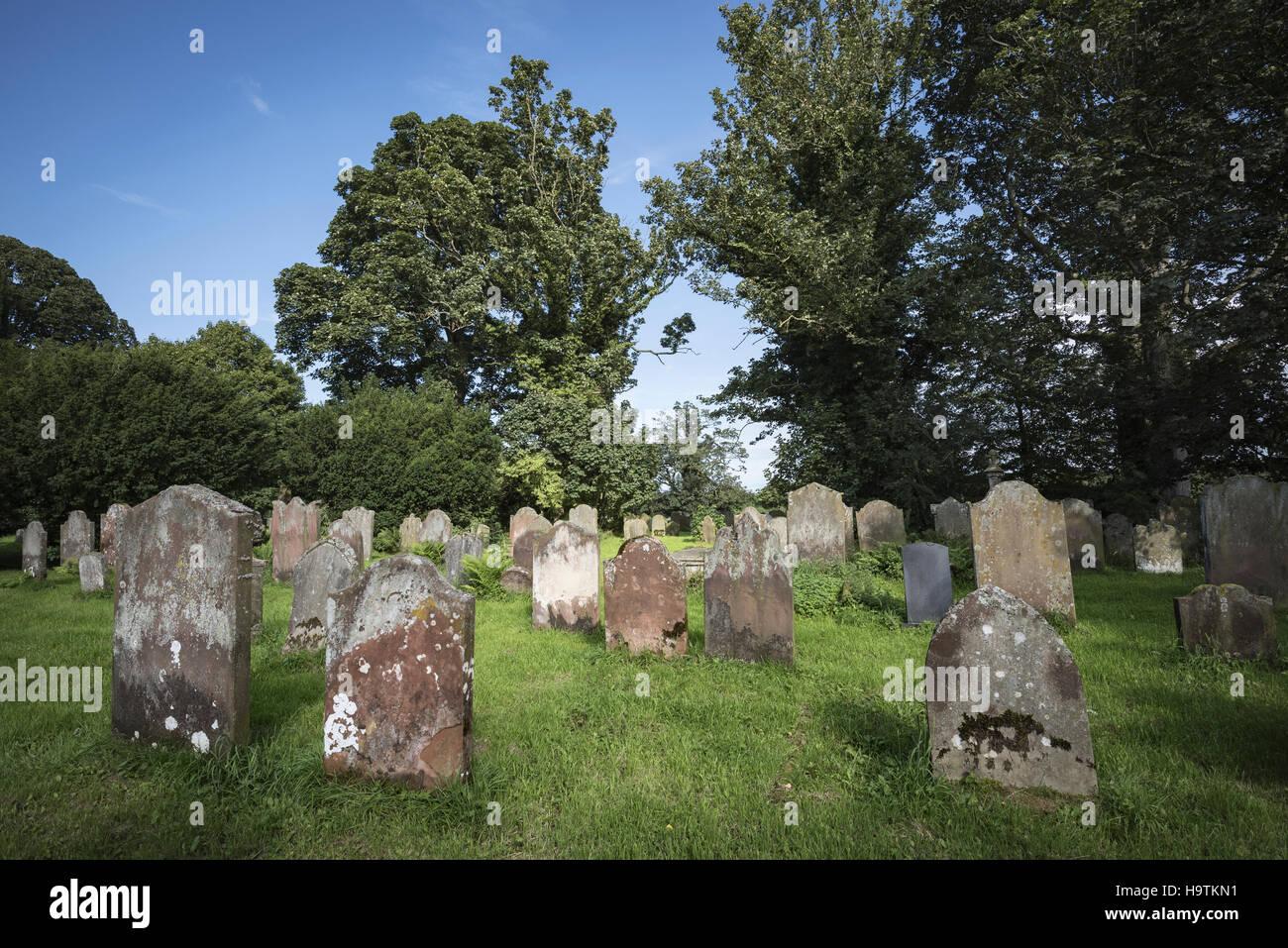 Old grave stones in cemetery, Cumbria, England, United Kingdom - Stock Image