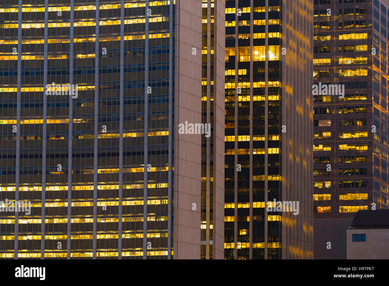The bright lights from three office towers at night in Sydney - Stock Image