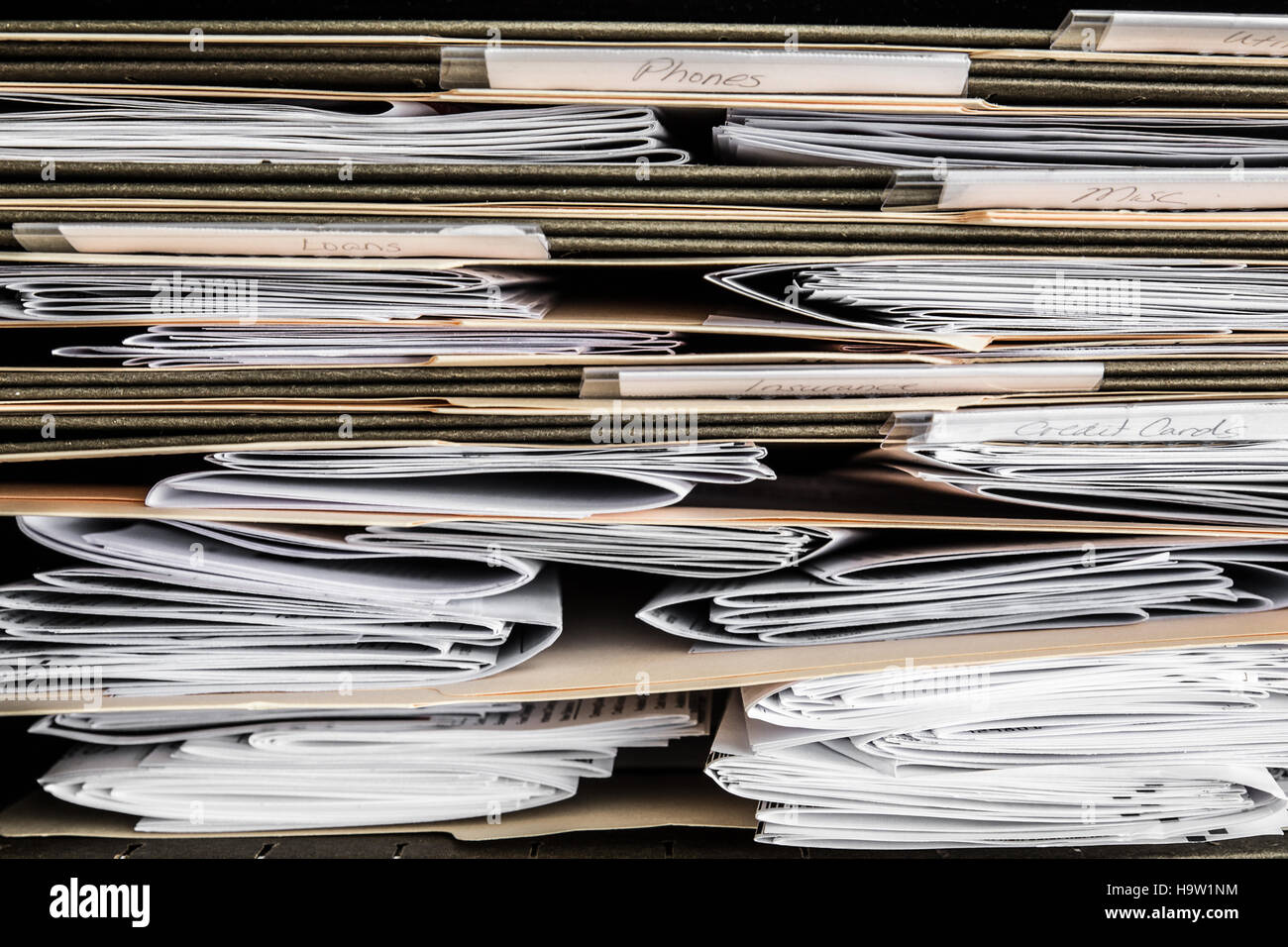 View of papers, bills and documents in file folders - Stock Image