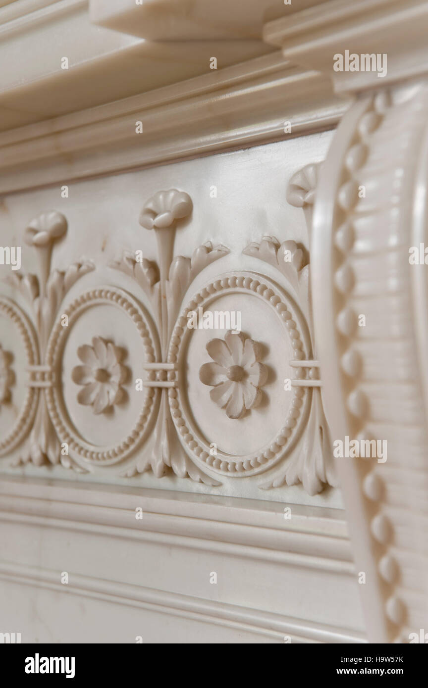 Detail of the floral motif on the fireplace in The Boudoir at Attingham Park, Shropshire. - Stock Image