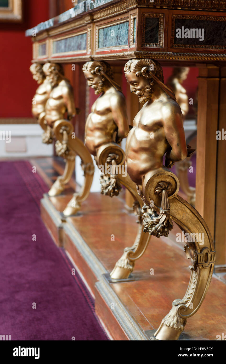 Gilt bronze satyr supports of a Louis XVI console table in the Picture Gallery at Attingham park, Shropshire. - Stock Image