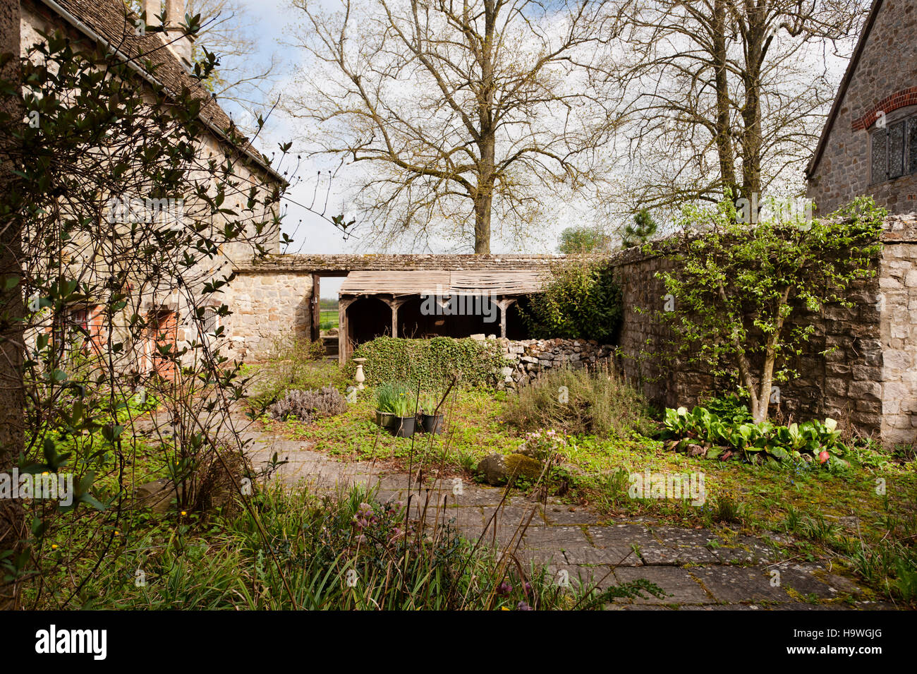 Wooden lean-to at the back of Avebury Manor, Wiltshire. - Stock Image