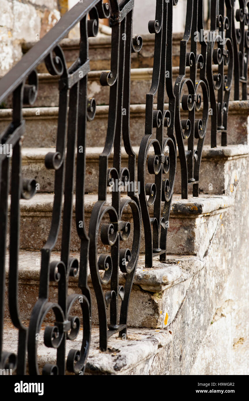 Wrought iron banisters on the steps at Avebury Manor, Wiltshire. Stock Photo
