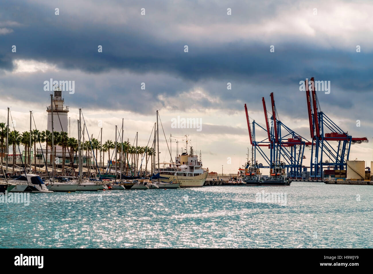 Lighthouse, Cargo dock, Commercial Port, Malaga, Andalucia, Spain, - Stock Image