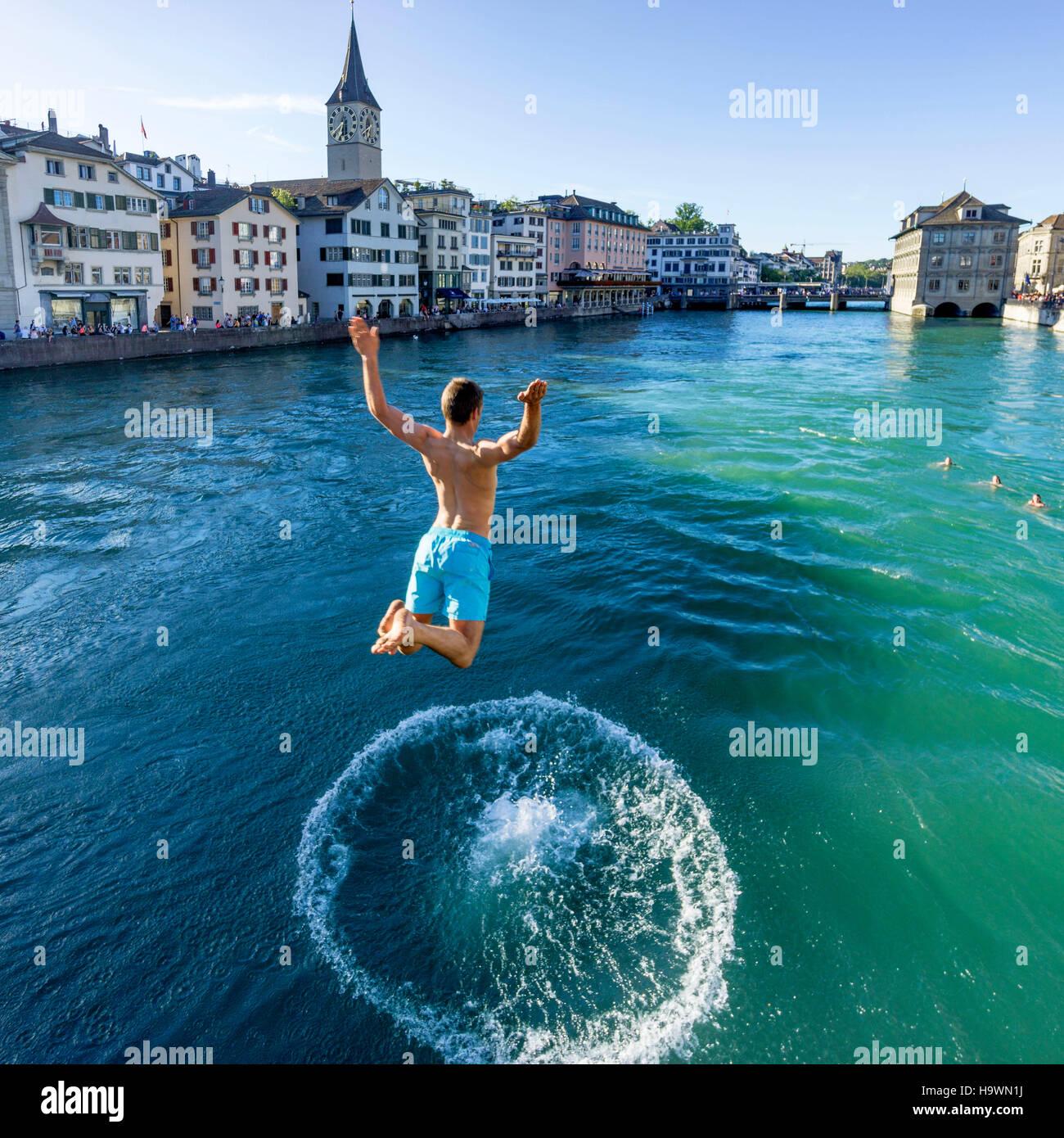 Man jumping into River Limmat, Zurich, Switzerland - Stock Image