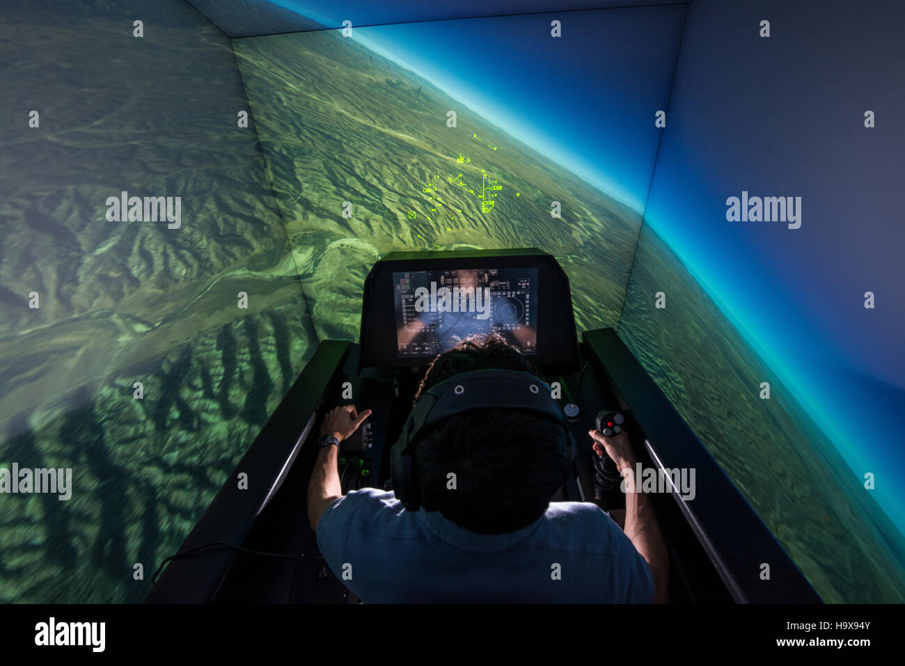 An aerospace engineer demonstrates the Automatic Ground Collision Avoidance System in an F-16 Fighting Falcon fighter - Stock Image