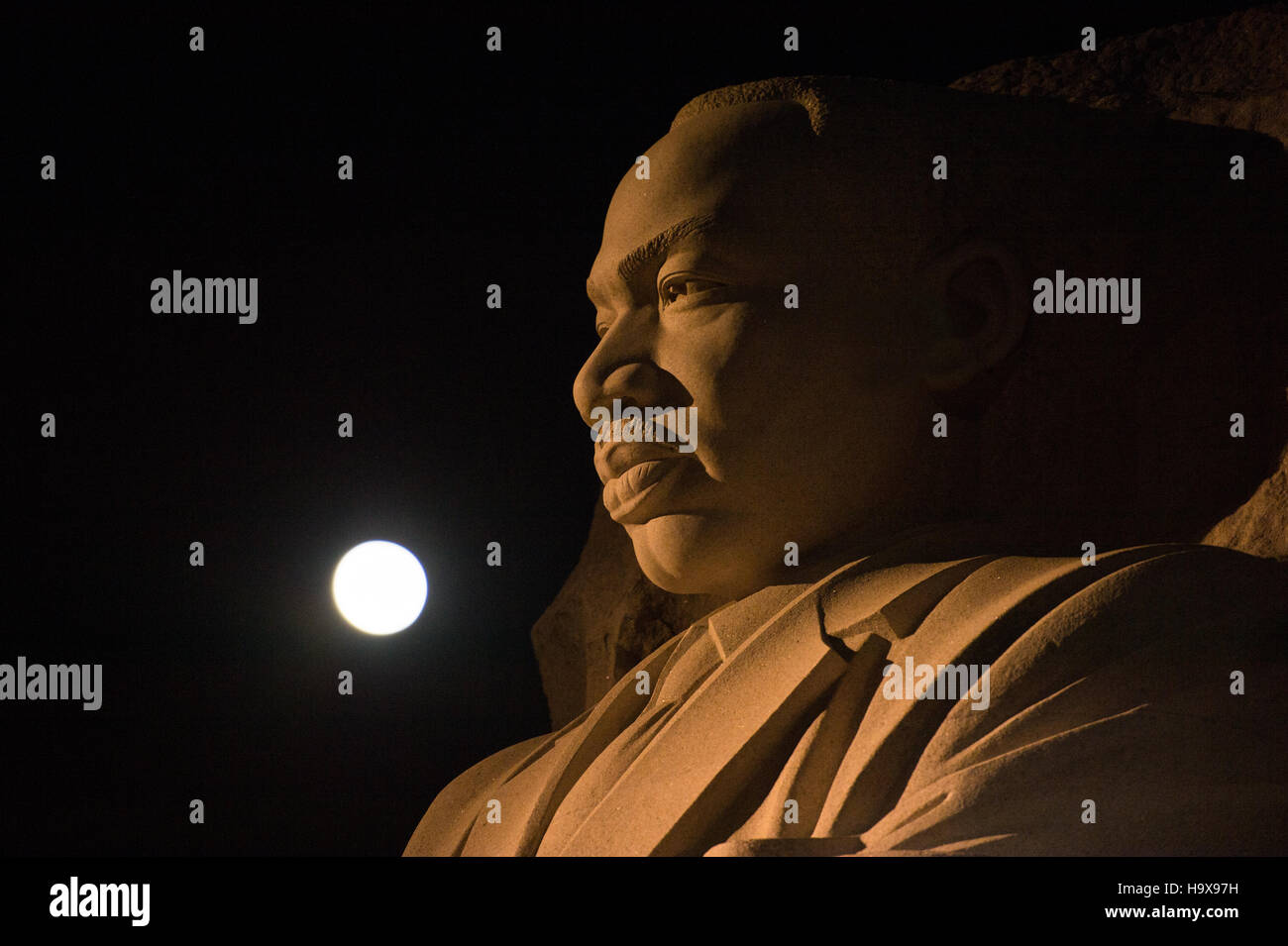 The supermoon sets over the Martin Luther King Jr. Memorial November 14, 2016 in Washington, DC. The moon appears - Stock Image