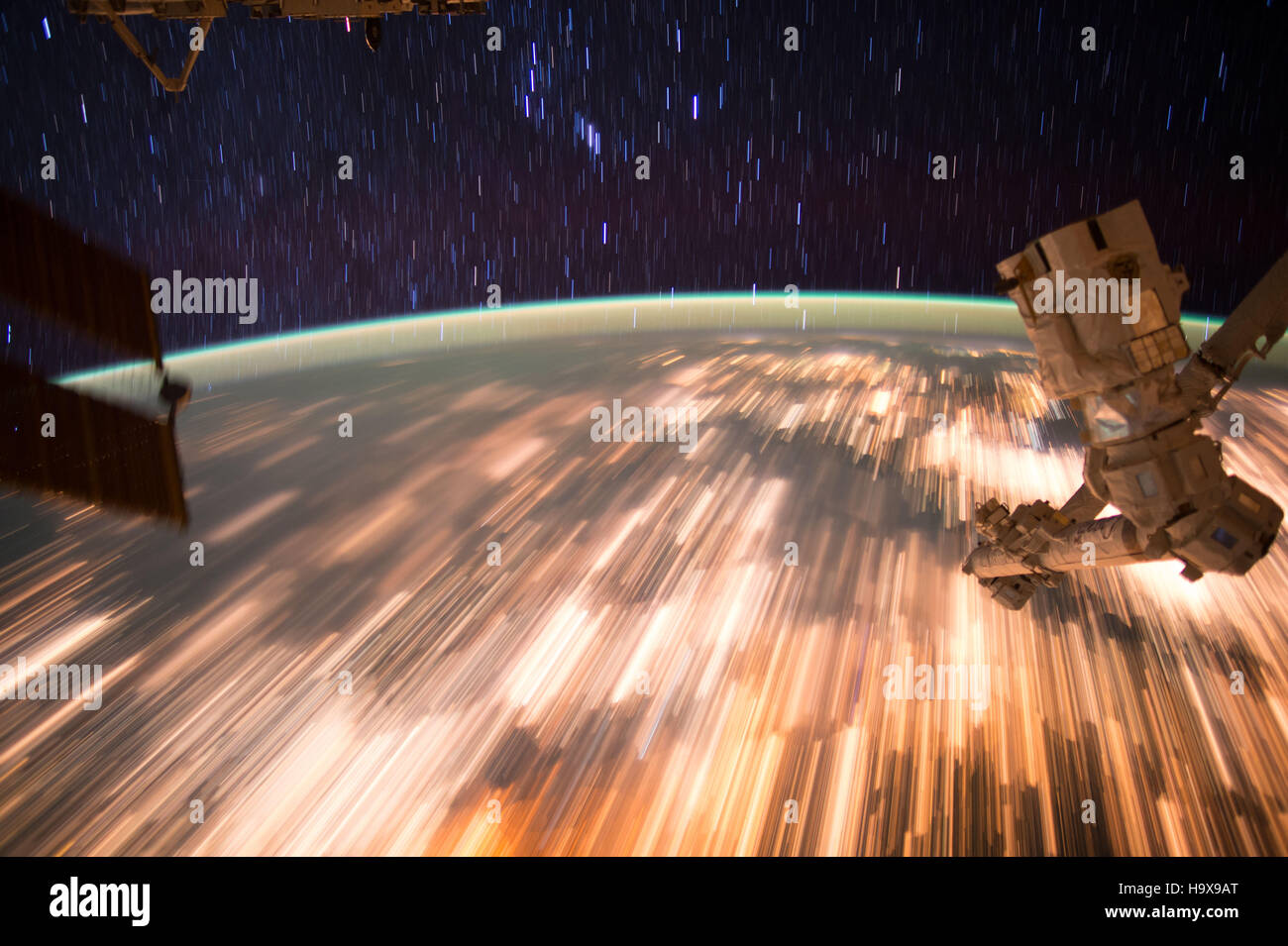 Astronauts aboard the NASA International Space Station captured a series of star trail images over the Earth surface - Stock Image