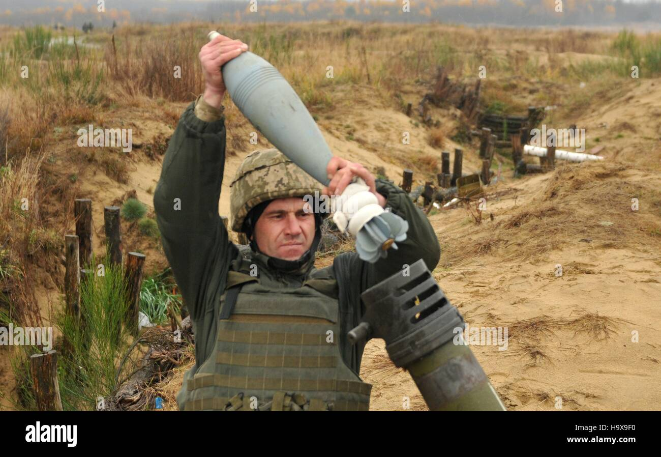 A Ukrainian soldier loads a round into a mortar system before a live-fire training exercise at the International - Stock Image